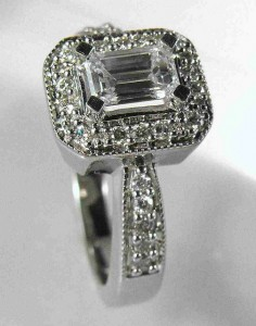 Photo by derrico_jewelry (Flickr): This four-prong emerald-cut diamond has a halo-like setting around it.
