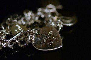 This charm and bracelet represent a personal accomplishment of running the New York City Marathon. Photo by slgckgc (Flickr)