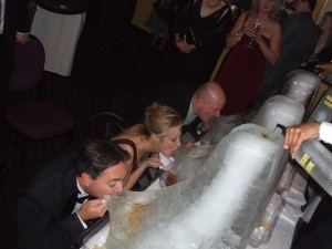 An ice luge is a great way to bring some fun to your wedding guests! Photo via http://ow.ly/VVqxS